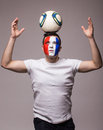 Football fan of France national team with ball on head and up hands Royalty Free Stock Photo