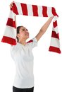 Football fan waving red and white scarf on background Royalty Free Stock Photo