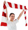 Football fan waving red and white scarf on background Stock Image