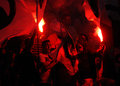 Football fans with flares rapid bucharest supporters light during the romanian league relegation play off between rapid bucharest Royalty Free Stock Images