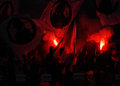 Football fans with flares rapid bucharest supporters light during the romanian league relegation play off between rapid bucharest Stock Images