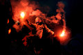 Football fans are launching a flare during polish league match Royalty Free Stock Images