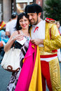 Football fans ready to go to match kiev ukraine jul spanish fan in toreador costume is photographed with ukrainian girl before Royalty Free Stock Image