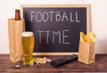 Football fans setting of beer bottle in brown paper bag,  glass, Royalty Free Stock Photo