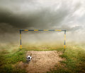 Football field goal deflated ball and cloudy sky Stock Photography