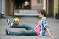 Football freestyle performed by the teenager Royalty Free Stock Image