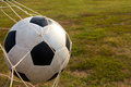Football on the goal net Royalty Free Stock Photo