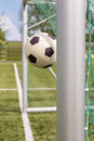 Football between goal posts plastic two for a winning shot Stock Image