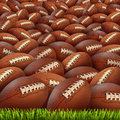 Football group on a grass field as an infinite background for sports and fitness symbol of an american team leisure activity Stock Photos