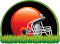 Football helmet on grass at night Stock Photo