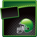 Football helmet on green and black halftone ad Stock Photo