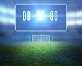 Football pitch with goalpost and scoreboard digitally generated Stock Photography