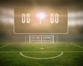 Football pitch with goalpost and scoreboard digitally generated Stock Photos