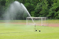 Football pitch watering in a Royalty Free Stock Photo