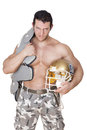 Football player big shirtless sexy with protection and helmet angry looking into the camera isolated on white background sport and Royalty Free Stock Photo