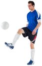 Football player in blue kicking ball on white background Royalty Free Stock Photo