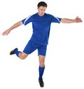 Football player in blue kicking on white background Royalty Free Stock Images