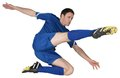 Football player in blue kicking on white background Royalty Free Stock Photo