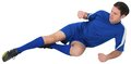 Football player in blue kicking on white background Royalty Free Stock Photos