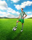 Football player on the football ground with ball Stock Images