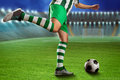 Football player on the football ground kicking ball Royalty Free Stock Images
