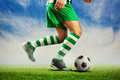 Football player on the football ground passing ball outdoor Royalty Free Stock Photos
