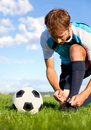 Football player getting ready Stock Photos
