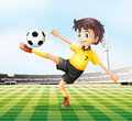 A football player kicking the ball illustration of Stock Image
