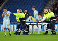 Football player reacts after teammate injury during uefa champions league game steaua s federico piovaccari his mihai pintilii Royalty Free Stock Image