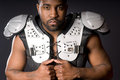 Football Player in Shoulder Pads Royalty Free Stock Images