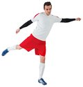 Football player in white kicking on background Royalty Free Stock Photo