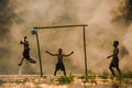 Football players The three children are playing football on the