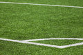 Football playing field background with green grass and white corner marking Stock Photography