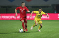 Football romania vs lithuania s gabriel torje r and s deimantas petravicius l in action during a friendly match played at Stock Photos