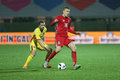 Football romania vs lithuania s lucian sanmartean l and s vykintas slivka r in action during a friendly match played at Royalty Free Stock Photography