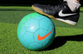 A football and a shoe closeup view of of nike brand Royalty Free Stock Photography