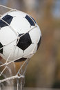 Football, soccer ball in goal net Royalty Free Stock Photo
