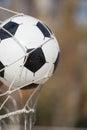 Football, soccer ball in goal net Royalty Free Stock Photo