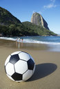 Football soccer ball red beach sugarloaf rio de janeiro brazil on at the foot of pao acucar mountain Royalty Free Stock Photos