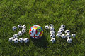 Football soccer balls green grass message for featuring international teams in field Stock Images