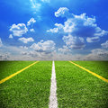 Football and soccer field grass stadium Blue sky background Royalty Free Stock Photo