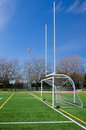Football and soccer gates on artificial turf field Stock Images
