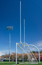 Football and soccer gates on artificial turf field Stock Photo