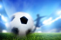 Football, soccer match. A player shooting ball on goal Royalty Free Stock Photo