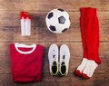 Football stuff on the floor various lined up a wooden background Royalty Free Stock Photos