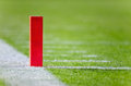 Football touchdown pylon selective focus photo of the and line on a field Royalty Free Stock Photos