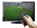 Football on tv male hand holding remote control with a game screen isolated white Stock Photo