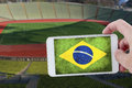 At the football world championship taking a picture with a smartphone stadium during brazil Stock Photography
