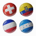Football worldcup group e football soccer balls set of d with flags Stock Images