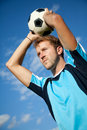 Footballer doing a throw in Stock Photo